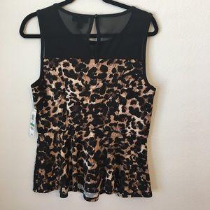 09462bc6eaa62c Thalia Sodi Tops - Thalia Sodi Stretch Leopard print Peplum top NWT